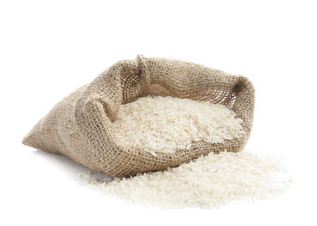 Bag with rice on white background Stock Photo