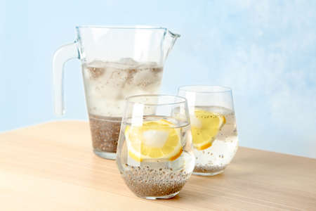 Glasses of water with chia seeds and lemon slices on table Stock Photo