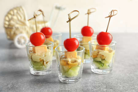 Delicious appetizers for baby shower on grey table