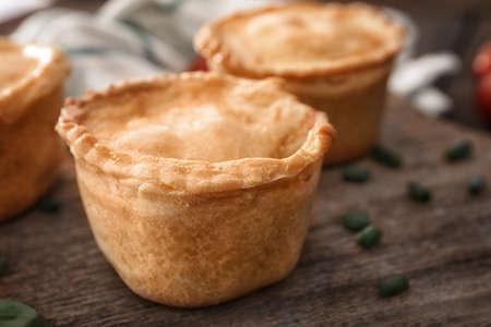 Delicious meat mini pie on board, closeup