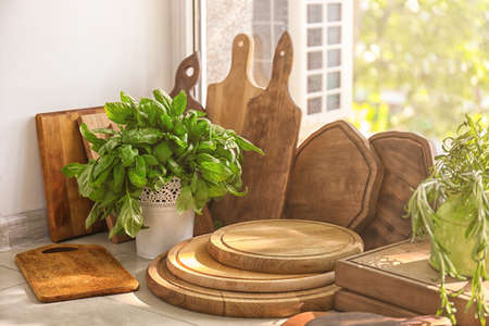 Different wooden boards on window sill in kitchen Stock Photo