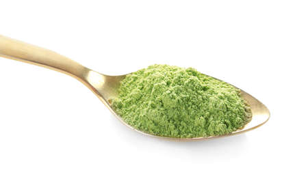 Spoon with natural wheat grass powder isolated on white Stock Photo