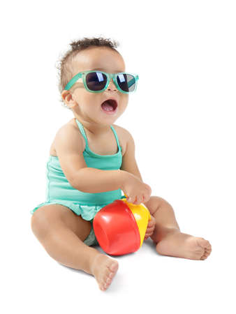 Cute little baby in swimsuit and sunglasses, isolated on white Stock Photo