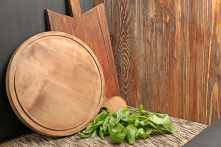 Cutting boards on wooden background
