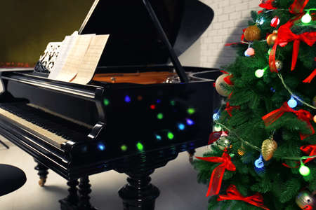 Beautiful piano and Christmas tree in room