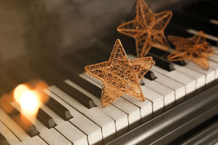 Piano keyboard with Christmas decoration, closeup