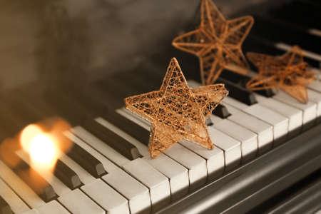 Piano keyboard with Christmas decoration, closeup