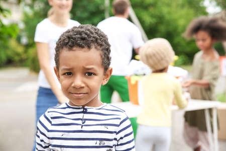Poor African boy outdoors