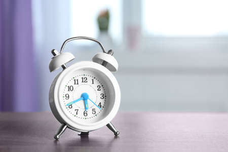 Alarm clock on window sill. Morning routine concept Stock Photo