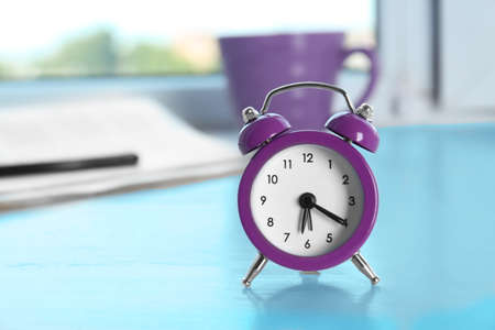 Alarm clock on window sill. Morning routine concept Stock Photo