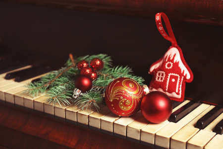 New year decorations on piano keyboard. Christmas music concept