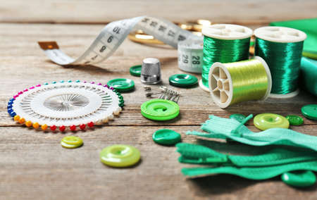 Accessories for sewing on wooden background Stock Photo