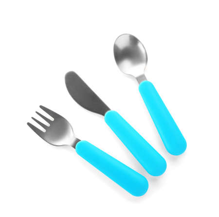 Colorful eating utensils for baby on white background