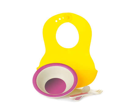 Bright baby tableware and bib on white background