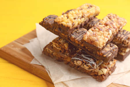 Healthy cereal bars on wooden table Stock Photo