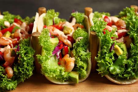 Delicious shrimp tacos on holder, closeup