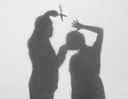 Silhouette of man trying to kill his wife on white background. Domestic violence concept