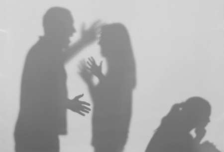 Silhouettes of quarreling parents and little child on white background. Domestic violence concept