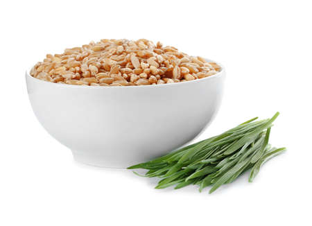 Bowl with seeds and wheat grass on white background