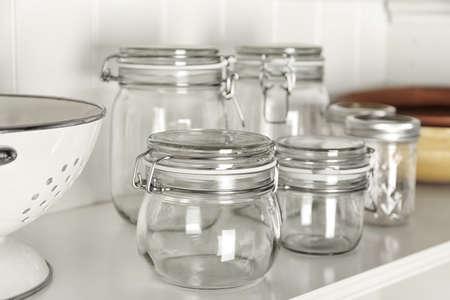 Glass jars on shelf Stock Photo