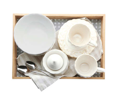 Tray with different tableware on white background