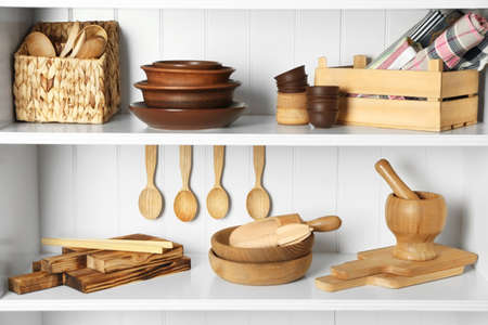 Different kitchenware on shelves