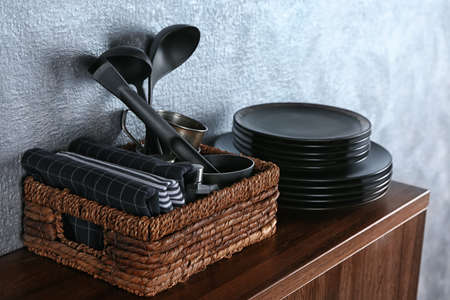 Different kitchenware on table