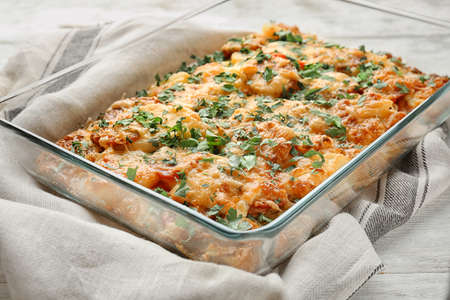 Delicious sausage casserole in baking dish on table Stock fotó