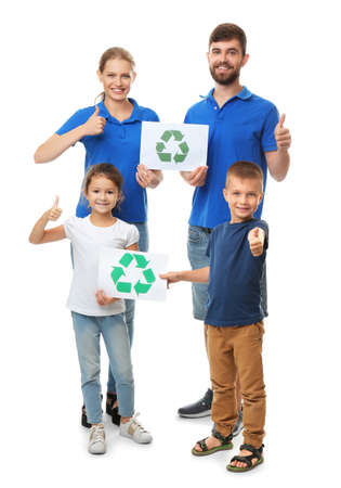 Family holding paper sheets with recycling symbol on white background