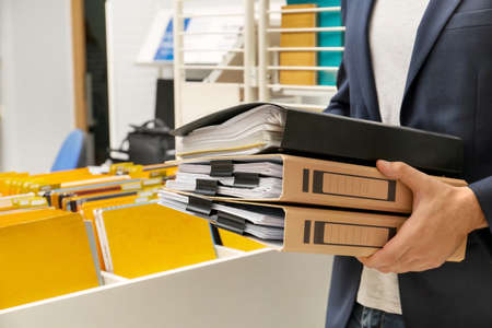 Man searching for documents in archive Stock Photo
