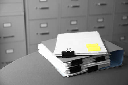 Folder with documents on table in archive