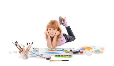 Talented girl painting against white background Stock Photo
