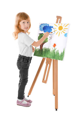 Talented girl painting on canvas against white background
