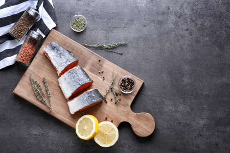 Board with fresh raw salmon on table Stock Photo