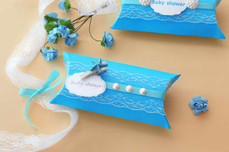 Cute baby shower favor on light background