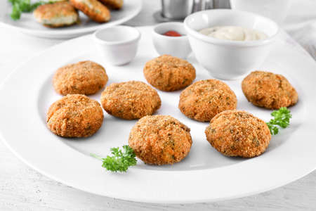 Delicious salmon patties on plate, closeup