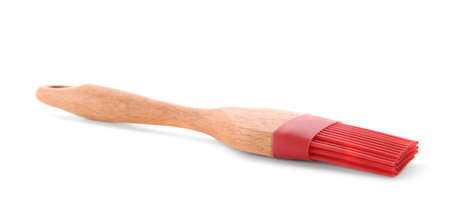Silicone brush with wooden handle on white background Stock Photo