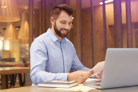 Handsome marketing manager working in cafe Stock Photo