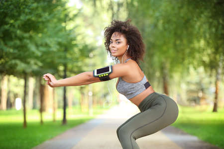Sporty African American woman training in park