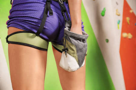 Sporty young woman applying talc on hands prior to training in climbing gym, closeup Banque d'images - 98875642