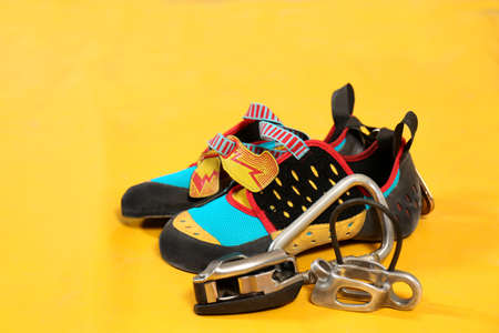 Shoes and carbine on sport mat