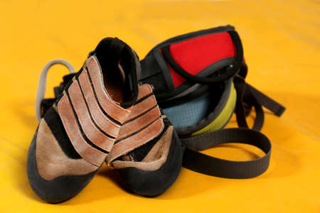 Shoes and climbing gear on sport mat Stock Photo
