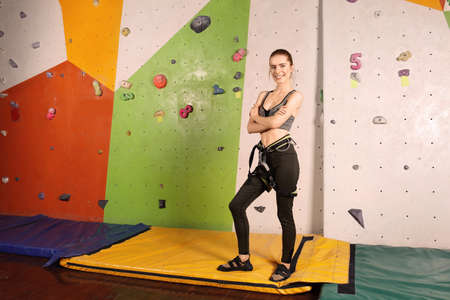 Sporty young woman in climbing gym Stock Photo