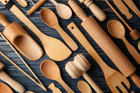 Various wooden kitchen utensils on table