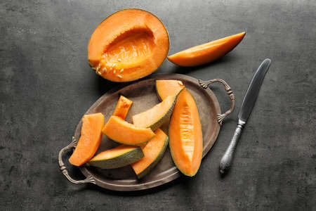 Composition with fresh ripe melon on grey background Stock Photo