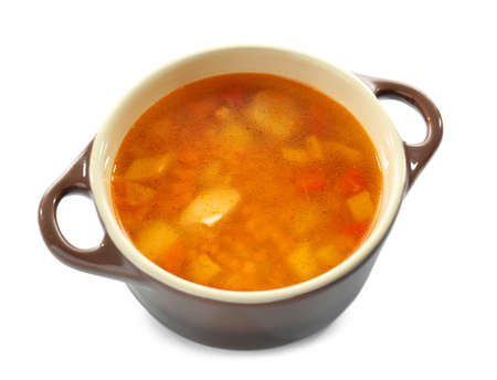 Casserole with tasty lentil soup on white background