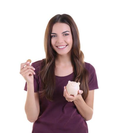 Beautiful young woman with piggy bank on white background Stock Photo