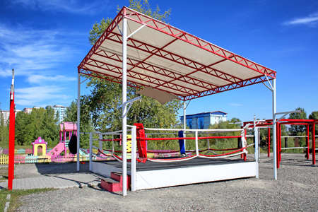 Boxing ring prepared for competition, outdoors Stock Photo