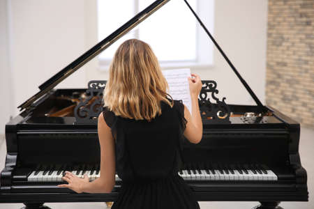 Talented woman playing piano indoors