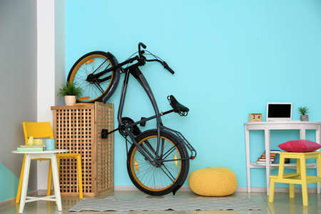 Modern bicycle in cozy room interior